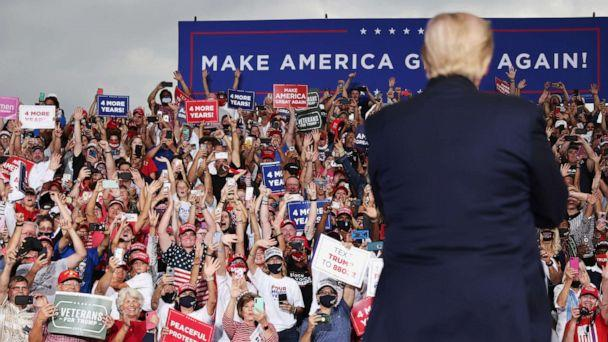 PHOTO: Supporters cheer as U.S. President Donald Trump speaks during a campaign event at Smith Reynolds Regional Airport in Winston-Salem, N.C., Sept. 8, 2020. (Jonathan Ernst/Reuters)