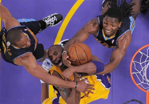 Los Angeles Lakers guard Kobe Bryant, center, grapples for the ball with Denver Nuggets guard Arron Afflalo, left, and forward Kenneth Faried during the first half in Game 5 of an NBA first-round playoff basketball game, Tuesday, May 8, 2012, in Los Angeles. (AP Photo/Mark J. Terrill)
