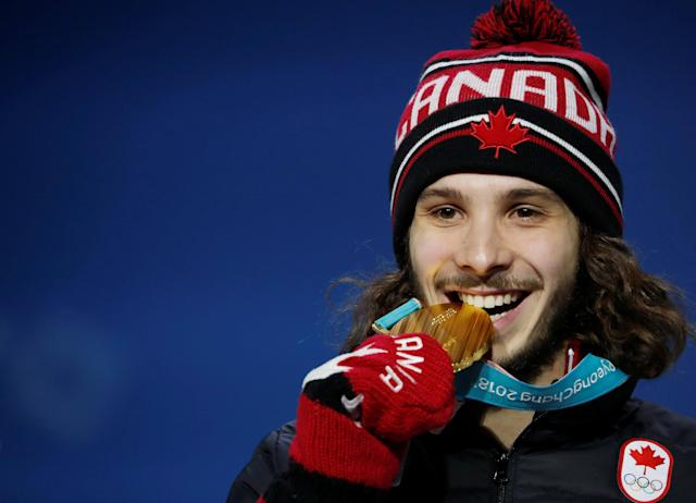 Medals Ceremony - Short Track Speed Skating Events - Pyeongchang 2018 Winter Olympics - Men's 1000m - Medals Plaza - Pyeongchang, South Korea - February 18, 2018 - Gold medalist Samuel Girard of Canada on the podium. REUTERS/Kim Hong-Ji TPX IMAGES OF THE DAY