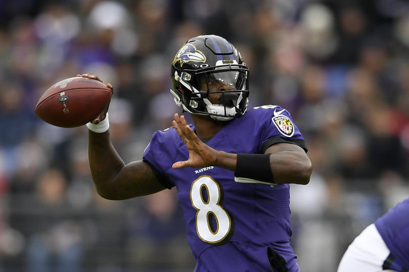Lamar Jackson throws a pass during a game.