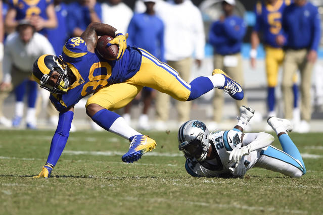 Los Angeles Rams running back Todd Gurley (30) is tripped up by Carolina Panthers cornerback James Bradberry. (AP)
