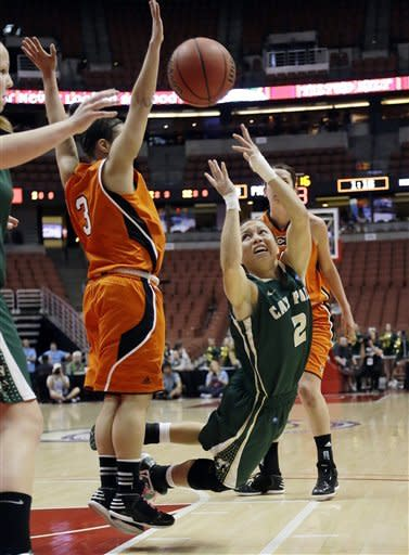 CORRECTS DAY OF WEEK - Cal Poly guard Jonae Ervin (2) is fouled and stumbles as she tries to shoot against Pacific's defense including guard Kristina Johnson (3) during the first half of an NCAA college basketball game in the championship of the Big West Conference tournament in Anaheim, Calif., Saturday, March 16, 2013. (AP Photo/Reed Saxon)