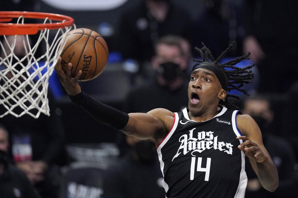 Los Angeles Clippers guard Terance Mann shoots during the second half in Game 6 of a second-round NBA basketball playoff series against the Utah Jazz Friday, June 18, 2021, in Los Angeles. (AP Photo/Mark J. Terrill)