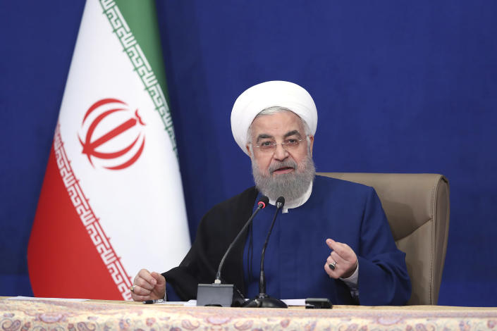 """In this photo released by the official website of the office of the Iranian Presidency, outgoing President Hassan Rouhani speaks in the last meeting of his cabinet in Tehran, Iran, Sunday, Aug. 1, 2021. Rouhani on Sunday acknowledged his nation at times """"did not tell part of the truth"""" to its people during his eight-year tenure, as he prepares to leave office with his signature nuclear deal with world powers in tatters and tensions high with the West. (Iranian Presidency Office via AP)"""
