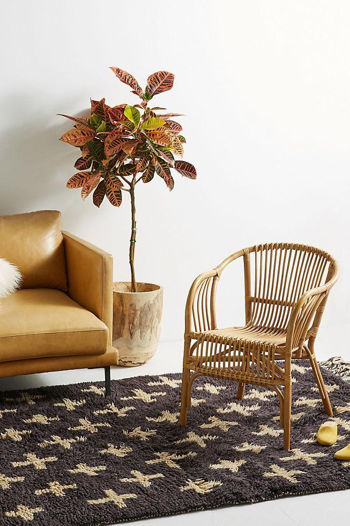 Cane furniture like this chair is about to be all the rage in 2021.