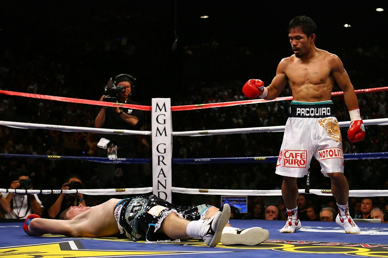LAS VEGAS - MAY 02: (R-L) Manny Pacquiao of the Philippines stands over Ricky Hatton of England after Pacquiao knocked him out in the second round during their junior welterweight title fight at the MGM Grand Garden Arena May 2, 2009 in Las Vegas, Nevada. (Photo by Al Bello/Getty Images)