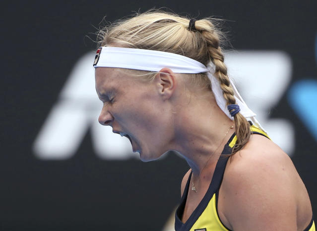 Kiki Bertens of the Netherlands yells out while playing Ash Barty of Australia during their women's singles semifinal match at the Sydney International tennis tournament in Sydney, Friday, Jan. 11, 2019. (AP Photo/Rick Rycroft)