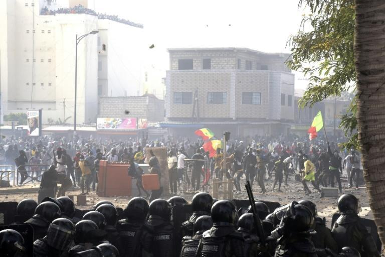 Protesters clash with police in the Colobane neighbourhood of Dakar following the arrest of main opposition leader Ousmane Sonko
