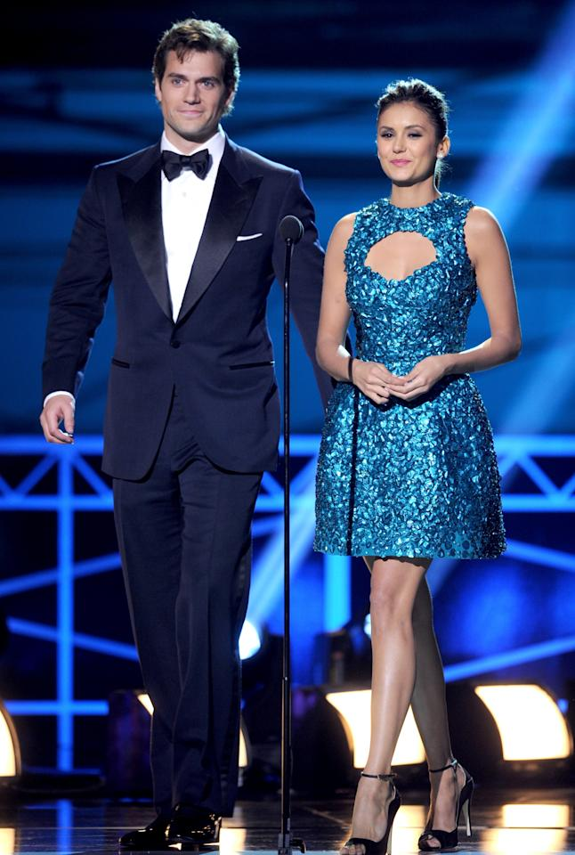 SANTA MONICA, CA - JANUARY 10:  Presenters Nina Dobrev (L) and Henry Cavill speak onstage at the 18th Annual Critics' Choice Movie Awards held at Barker Hangar on January 10, 2013 in Santa Monica, California.  (Photo by Kevin Winter/Getty Images)