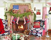 """<p>In the living room of <a href=""""https://www.countryliving.com/home-design/house-tours/g3857/christmas-camp-decorating-ideas/"""" rel=""""nofollow noopener"""" target=""""_blank"""" data-ylk=""""slk:this California cabin"""" class=""""link rapid-noclick-resp"""">this California cabin</a>, a massive stone fireplace and quilt-covered armchairs make for a cozy storytelling station.</p><p><strong><a class=""""link rapid-noclick-resp"""" href=""""https://www.amazon.com/Festive-Striped-Cotton-Christmas-Stocking/dp/B01I46SOW2/?tag=syn-yahoo-20&ascsubtag=%5Bartid%7C10050.g.1247%5Bsrc%7Cyahoo-us"""" rel=""""nofollow noopener"""" target=""""_blank"""" data-ylk=""""slk:SHOP STOCKINGS"""">SHOP STOCKINGS</a></strong></p>"""