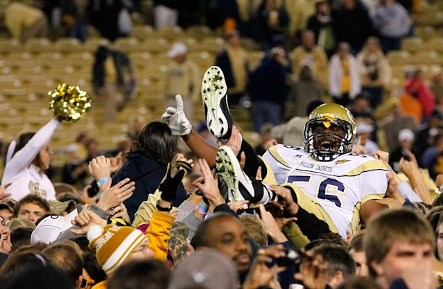 ATLANTA, GA - OCTOBER 29: Anthony Williams #56 of the Georgia Tech Yellow Jackets is carried in the air by fans after their 31-17 win over the Clemson Tigers at Bobby Dodd Stadium on October 29, 2011 in Atlanta, Georgia. (Photo by Kevin C. Cox/Getty Images)