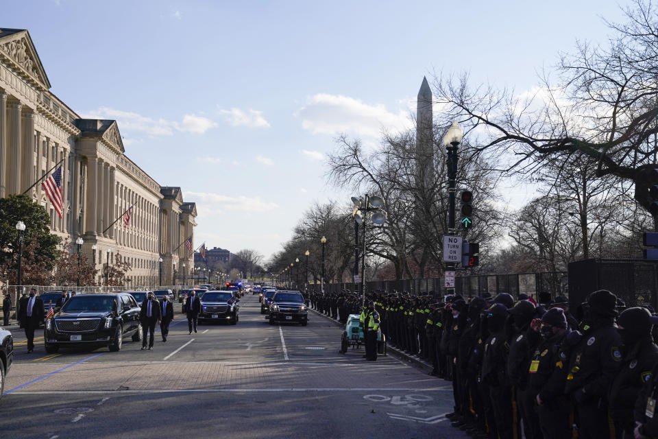FILE - The Presidential motorcade drives during Inauguration Day ceremonies Wednesday, Jan. 20, 2021, in Washington. On Friday, Jan. 22, the Associated Press reported on stories circulating online incorrectly claiming troops in Washington turned their backs on President Joe Biden's motorcade as it passed on its way to his inauguration at the U.S. Capitol. (AP Photo/Evan Vucci)