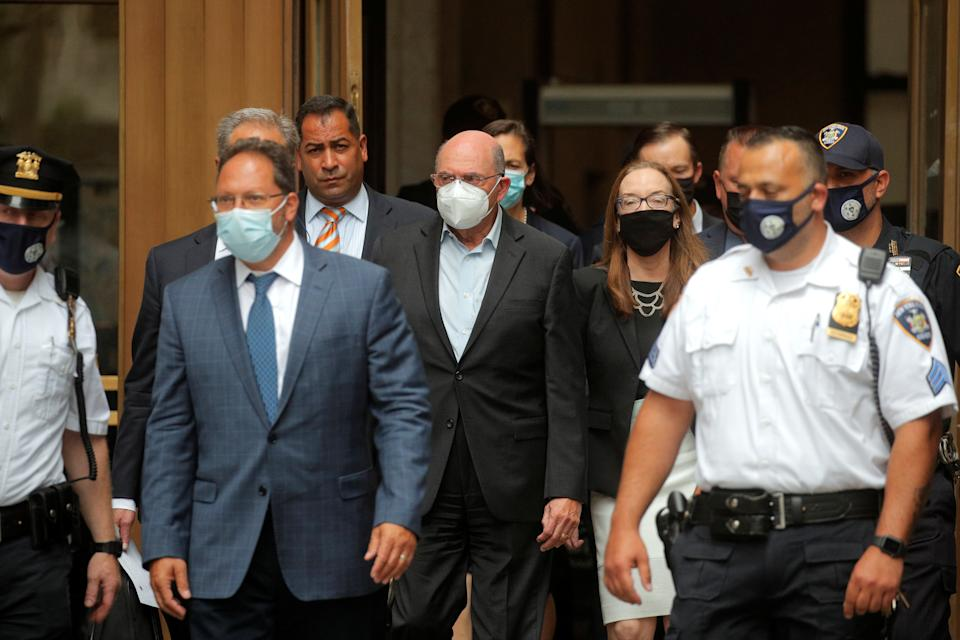 Trump Organisation chief financial officer Allen Weisselberg, centre, exits after his arraignment hearing.