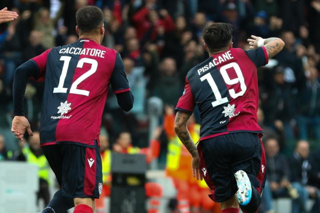 Cagliari's Fabio Pisacane, right, celebrates after scoring his sides' second goal during a Serie A soccer match between Cagliari and Fiorentina at the Sardegna Arena stadium in Cagliari, Italy, Sunday, Nov. 10, 2019. (Fabio Murru/ANSA via AP)