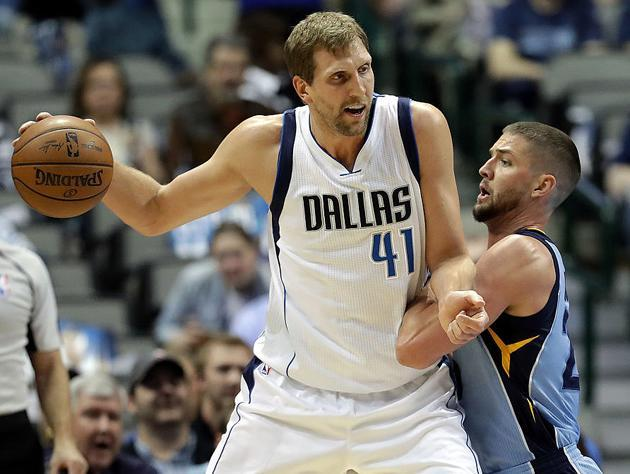 "<a class=""link rapid-noclick-resp"" href=""/nba/players/3252/"" data-ylk=""slk:Dirk Nowitzki"">Dirk Nowitzki</a> posts up friend of the program Chandler Parsons. (Getty Images)"