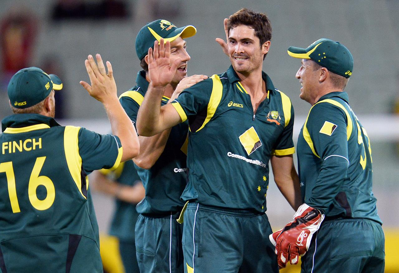 Australian paceman Ben Cutting (2/R) is congratulated by teammates Aaron Finch (L), Shaun Marsh (2/L) and Brad Haddin (R) after dismissing West Indies batsman Narsingh Deonarine in their one-day cricket international played at the Melbourne Cricket Ground (MCG), on February 10, 2013.  AFP PHOTO/William WEST  IMAGE RESTRICTED TO EDITORIAL USE - STRICTLY NO COMMERCIAL USE        (Photo credit should read WILLIAM WEST/AFP/Getty Images)