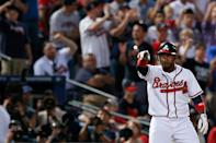 Jose Constanza #13 of the Atlanta Braves reacts from thrid base after he hits a triple in the seventh inning against the St. Louis Cardinals during the National League Wild Card playoff game at Turner Field on October 5, 2012 in Atlanta, Georgia. (Photo by Kevin C. Cox/Getty Images)