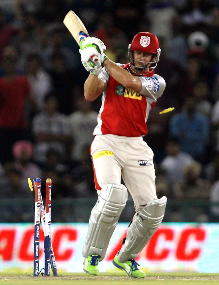 Adam Gilchrist is bowled by Darren Sammy during match 59 of of the Pepsi Indian Premier League between The Kings XI Punjab and the Sunrisers Hyderabad held at the PCA Stadium, Mohali, India  on the 11th May 2013. (BCCI)