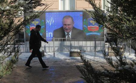 A screen, showing Russian President Vladimir Putin's annual end-of-year news conference, is on display in Simferopol