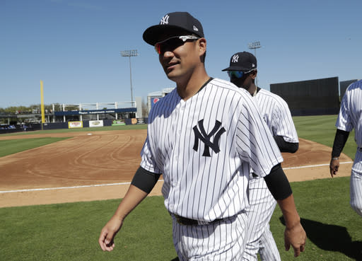 FILE - In this Monday, Feb. 25, 2019, file photo, New York Yankees pitcher Masahiro Tanaka, of Japan, walks to the dugout before a spring training baseball game against the Toronto Blue Jays in Tampa, Fla. Tanaka will be the Yankees' opening day starter March 28 against Baltimore, taking the spot left open by Luis Severino's shoulder trouble. (AP Photo/Lynne Sladky, File)