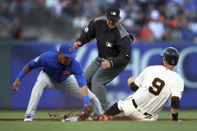 San Francisco Giants' Brandon Belt (9) is tagged out by Chicago Cubs' Addison Russell, left, in the second inning of a baseball game Monday, July 9, 2018, in San Francisco. Giants' Brandon Crawford was out at first base on the double play. (AP Photo/Ben Margot)