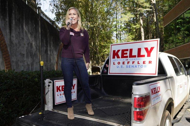 Majorie Taylor Green, pictured here on the back of a campaign truck endorsing Republican senator Kelly Loeffler . Source: AP
