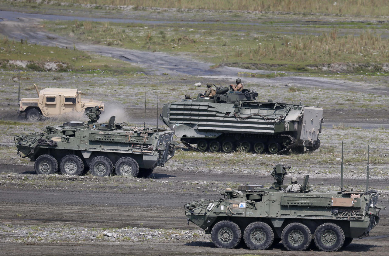 "<p> U.S. military armored personnel carriers take their positions during the 11-day joint US-Philippines military exercise dubbed ""Balikatan 2016"" (Shoulder-To-Shoulder 2016) Thursday, April 14, 2016 at Crow Valley, Tarlac province north of Manila, Philippines. U.S. Defense Secretary Ash Carter arrived in the country Wednesday for talks with President Benigno Aquino III and other top defense and military officials and to visit two military camps which are being utilized for the exercise.(AP Photo/Bullit Marquez) </p>"