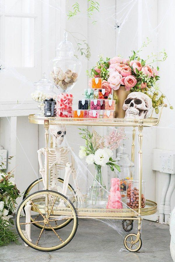 "<p>Decorate your table with skulls, spiderwebs, then fill jars with candy. Is it weird that we think this looks insanely chic? Get the tutorial at <a href=""https://sugarandcharm.com/2016/10/perfect-halloween-candy-cart.html?section-15"" rel=""nofollow noopener"" target=""_blank"" data-ylk=""slk:Sugar and Charm"" class=""link rapid-noclick-resp"">Sugar and Charm</a>.</p><p><a class=""link rapid-noclick-resp"" href=""https://www.amazon.com/dp/B07GB141DN/ref=dp_prsubs_3?tag=syn-yahoo-20&ascsubtag=%5Bartid%7C10057.g.2554%5Bsrc%7Cyahoo-us"" rel=""nofollow noopener"" target=""_blank"" data-ylk=""slk:BUY NOW"">BUY NOW</a> <em><strong>Poseable Halloween Skeletons, $18</strong></em></p>"