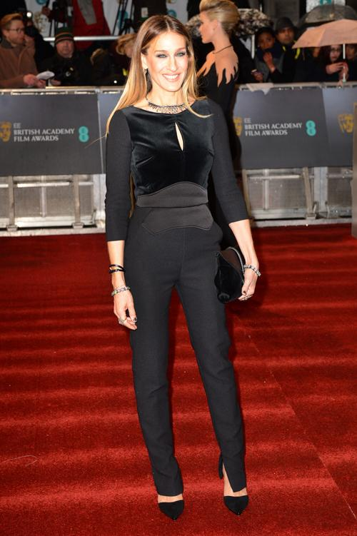 "Sarah Jessica Parker showed off her super trim figure in this season's classic - a <a target=""_blank"" href=""http://uk.lifestyle.yahoo.com/photos/top-10-jumpsuits-on-the-high-street-slideshow/"">black jumpsuit</a> - by Elie Saab,paired with black clutch and neat stilettos. She wore her hair sleek, styled by official BAFTA Stylist Charles Worthington.<br><br>©Getty"