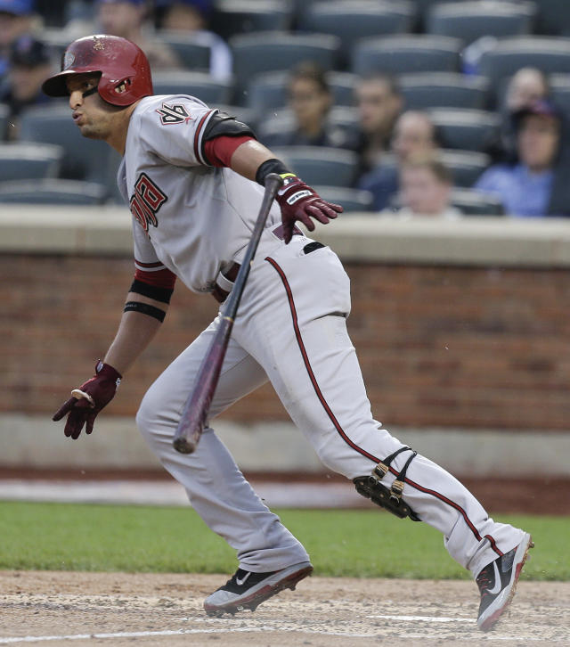 Arizona Diamondbacks' Martin Prado (14) watches his base hit to score Paul Goldschmidt from second base during the third inning of a baseball game against the New York Mets, Saturday, May 24, 2014, in New York. (AP Photo/Julie Jacobson)