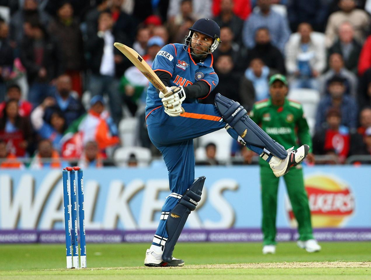 NOTTINGHAM, ENGLAND - JUNE 06:  Yuvraj Singh of India hits out during the ICC Twenty20 World Cup match between India and Bangladesh at Trent Bridge on June 6, 2009 in Nottingham, England.  (Photo by Laurence Griffiths/Getty Images)