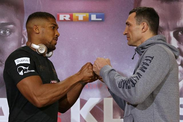 Britain's Anthony Joshua (L) sizes up Ukraine's Wladimir Klitschko during a joint press conference in London on April 27, 2017 ahead of their IBF, IBO and WBA Super, world Heavyweight title fight at Wembley Stadium (AFP Photo/Daniel LEAL-OLIVAS)