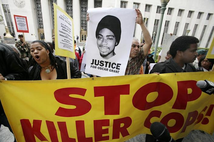 Protesters call for justice in the killing of Oscar Grant on 13 June 2011 at the US district court building in Los Angeles.