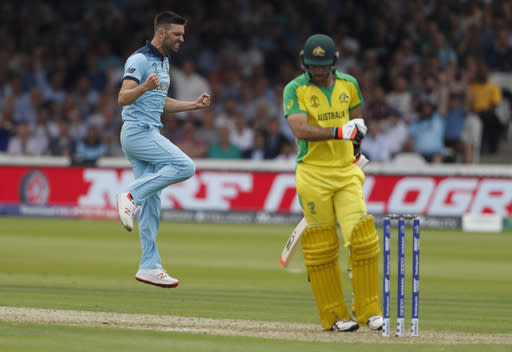 CORRECTS ID England's Mark Wood celebrates after taking the wicket of Australia's Glenn Maxwell caught behind during their Cricket World Cup match between England and Australia at Lord's cricket ground in London, Tuesday, June 25, 2019. (AP Photo/Alastair Grant)