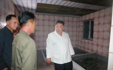 """Kim criticised dirty hot spring bathtubs at the Onpho holiday camp, calling them """"worse than fish tanks"""" - Credit: AFP"""