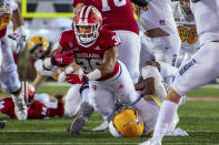 Indiana running back Chris Childers (36) is tackled by Idaho linebacker Tre Walker during the second half of an NCAA college football game Saturday, Sept. 11, 2021, in Bloomington, Ind. (AP Photo/Doug McSchooler)
