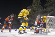 <p>STATELINE, NEVADA - FEBRUARY 21: Charlie Coyle #13 of the Boston Bruins scores a second period goal past Carter Hart #79 of the Philadelphia Flyers during the 'NHL Outdoors At Lake Tahoe' at the Edgewood Tahoe Resort on February 21, 2021 in Stateline, Nevada. (Photo by Christian Petersen/Getty Images)</p>