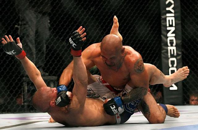 ATLANTA, GA - APRIL 21: Eddie Yagin (top) punches Mark Hominick during their featherweight bout for UFC 145 at Philips Arena on April 21, 2012 in Atlanta, Georgia.