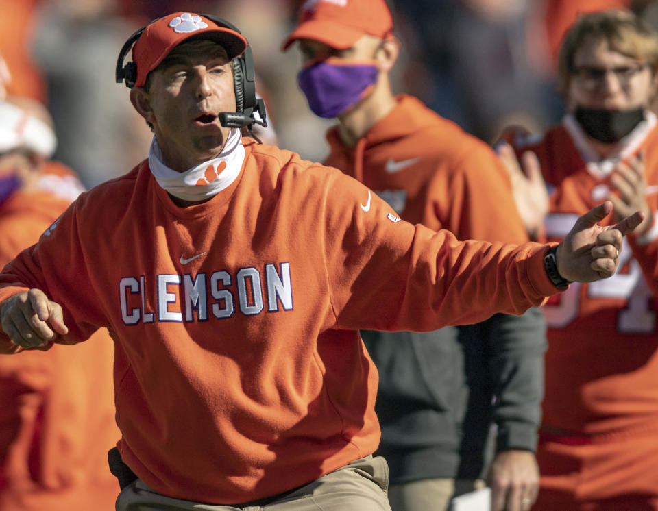 FILE - In this Oct. 31, 2020, file photo, Clemson head coach Dabo Swinney talks with players during the second half of an NCAA college football game against Boston College, Saturday, Oct. 31, 2020, in Clemson, S.C. Swinney, the coach of No. 3 Clemson, faces No. 5 Georgia in the season-opener in Charlotte, N.C. (Josh Morgan/Pool Photo via AP, File)
