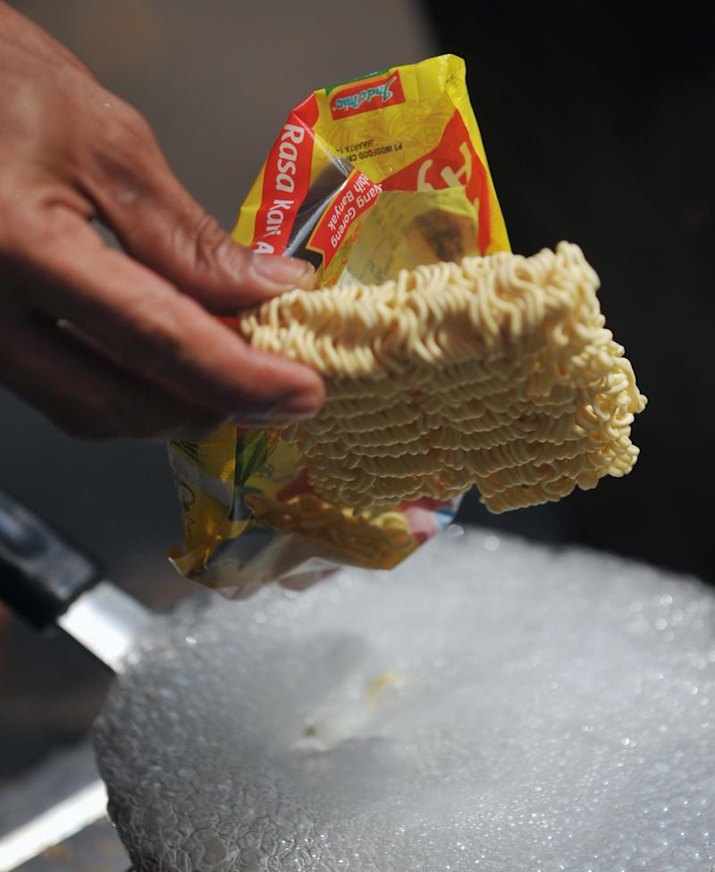 A vendor prepares instant noodles in Jakarta on October 12, 2010