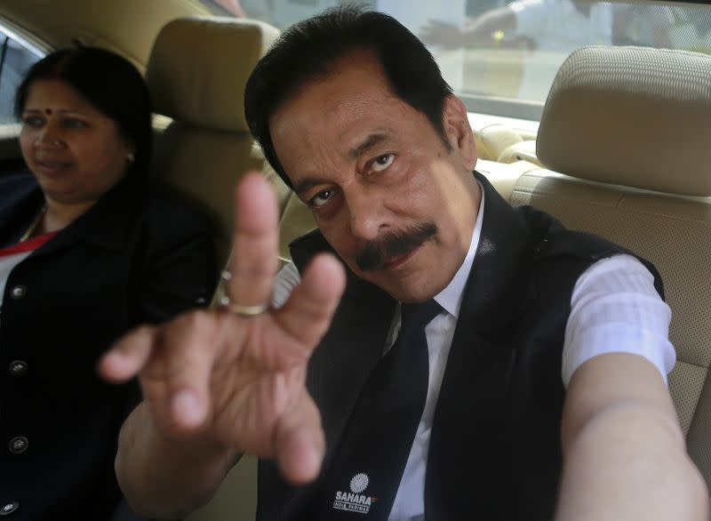 Sahara Group Chairman Roy gestures as he arrives at the Securities and Exchange Board of India headquarters in Mumbai