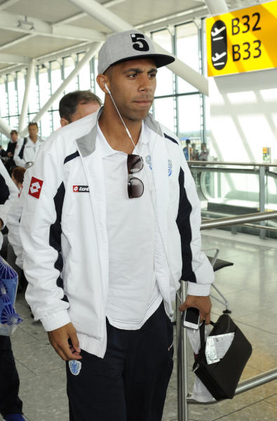QPR footballer Anton Ferdinand departs Heathrow Airport in London, for a pre-season tour with his soccer club in Asia. Queens Park Rangers soccer squad is heading to Asia for a pre-season tour to keep them get match fit and prepare for the upcoming new soccer season. (AP Photo) UNITED KINGDOM OUT - NO SALES - NO MAGS