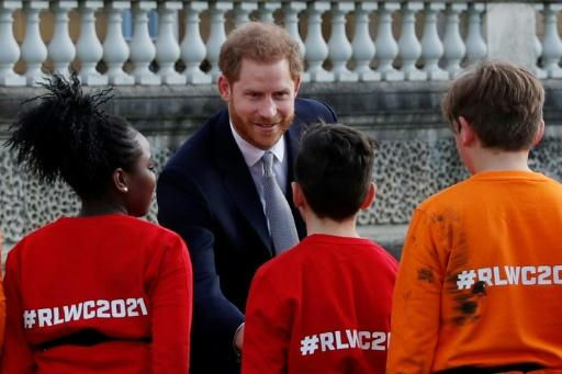 Prince Harry appeared relaxed and jovial despite the tumult surrounding him