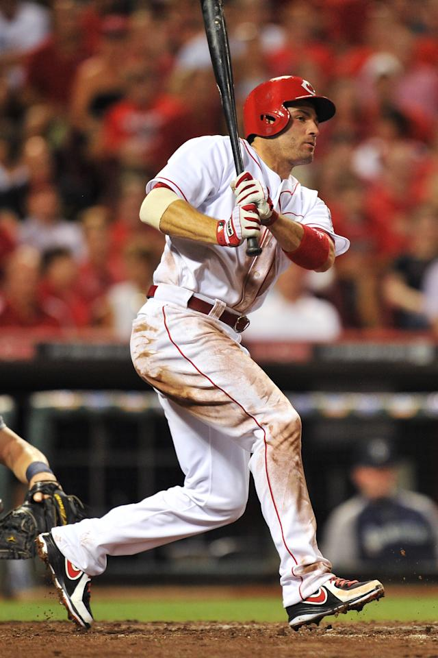 CINCINNATI, OH - JULY 5: Joey Votto #19 of the Cincinnati Reds bats in the eighth inning against the Seattle Mariners at Great American Ball Park on July 5, 2013 in Cincinnati, Ohio. Seattle defeated Cincinnati 4-2. (Photo by Jamie Sabau/Getty Images)