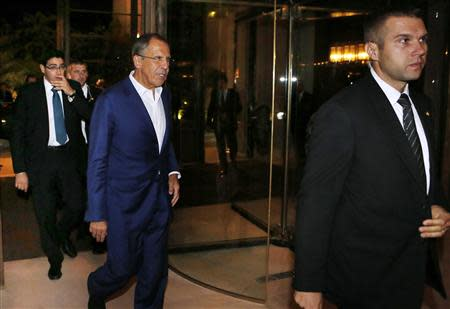Russian Foreign Minister Sergey Lavrov (C) arrives at a hotel for a late continuation of meetings with U.S. Secretary of State John Kerry (not seen) about the ongoing problems in Syria, in Geneva September 13, 2013. REUTERS/Larry Downing