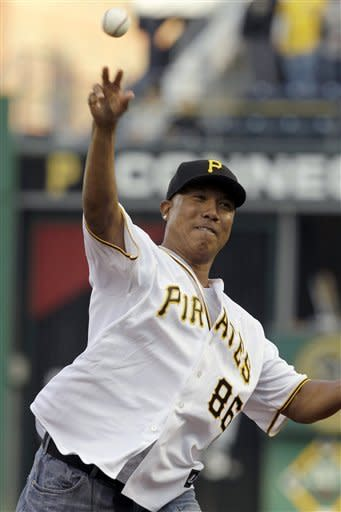 Retired Pittsburgh Steelers receiver Hines Ward throws out the ceremonial first pitch before a baseball game between the Pittsburgh Pirates and the Washington Nationals in Pittsburgh, Thursday, May 10, 2012. (AP Photo/Gene J. Puskar)