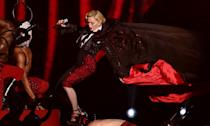 """Madonna should've taken some <a href=""""https://www.youtube.com/watch?v=2OvwPTmrUsA"""" rel=""""nofollow noopener"""" target=""""_blank"""" data-ylk=""""slk:advice from The Incredibles' Edna Mode"""" class=""""link rapid-noclick-resp"""">advice from The Incredibles' Edna Mode</a> ahead of her 2015 performance and left the cape at home. The singer's costume was put on too tightly around her neck so when it was time for the garment to be ripped away, it just took Madge with it and <a href=""""https://news.yahoo.com/cape-calm-carry-madonna-mocked-brits-tumble-091124273.html"""" data-ylk=""""slk:she was pulled off the stage;outcm:mb_qualified_link;_E:mb_qualified_link;ct:story;"""" class=""""link rapid-noclick-resp yahoo-link"""">she was pulled off the stage</a>. (PA)"""