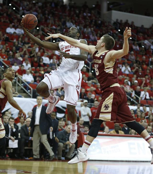 N.C. State's Desmond Lee (5) drives to the basket as Boston College's Joe Rahon (25) defends during the first half of N.C. State's game against Boston College at PNC Arena in Raleigh, N.C., Sunday, March 9, 2014. (AP Photo/The News & Observer, Ethan Hyman)