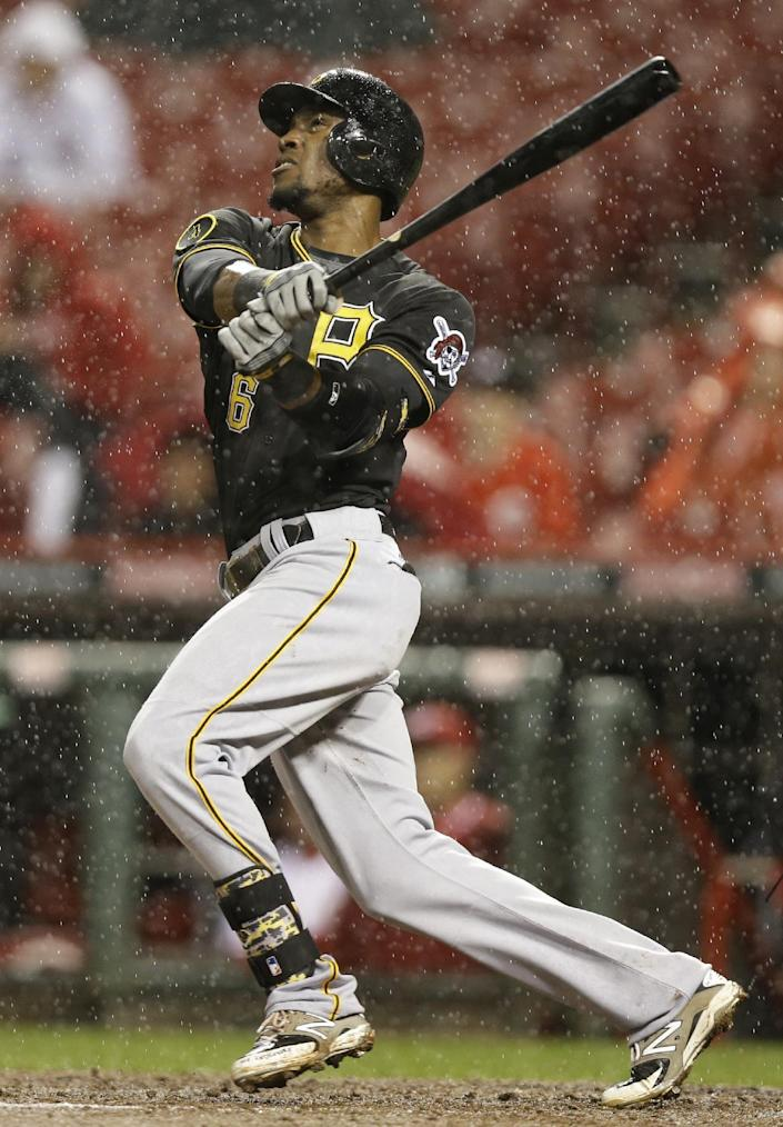 Pittsburgh Pirates' Starling Marte hits a solo home run off Cincinnati Reds starting pitcher Homer Bailey in the fifth inning of a baseball game, Monday, April 14, 2014, in Cincinnati. (AP Photo/Al Behrman)