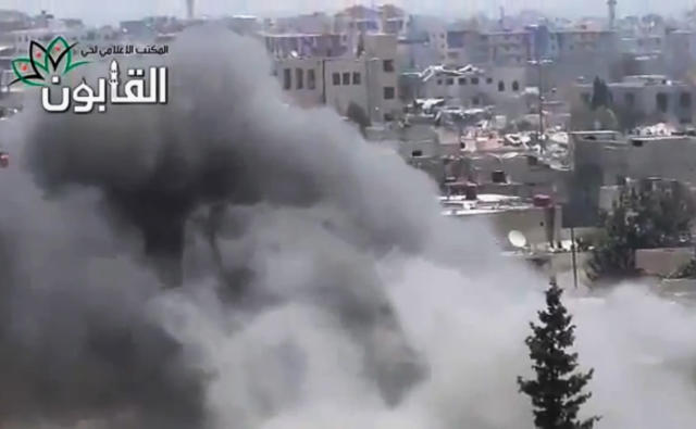 This image made from amateur video released by Ugarit News, which has been authenticated based on its contents and other AP reporting, shows smoke rises in Damascus, Syria, Friday, June 21, 2013. The commander of Syria's rebels confirms they have received new weapons, giving his forces more power in battles against government troops and Hezbollah fighters from Lebanon. Gen. Salim Idris refused to say in an interview with Al-Jazeera TV Friday where the weapons came from. (AP Photo/Ugarit News via AP video)